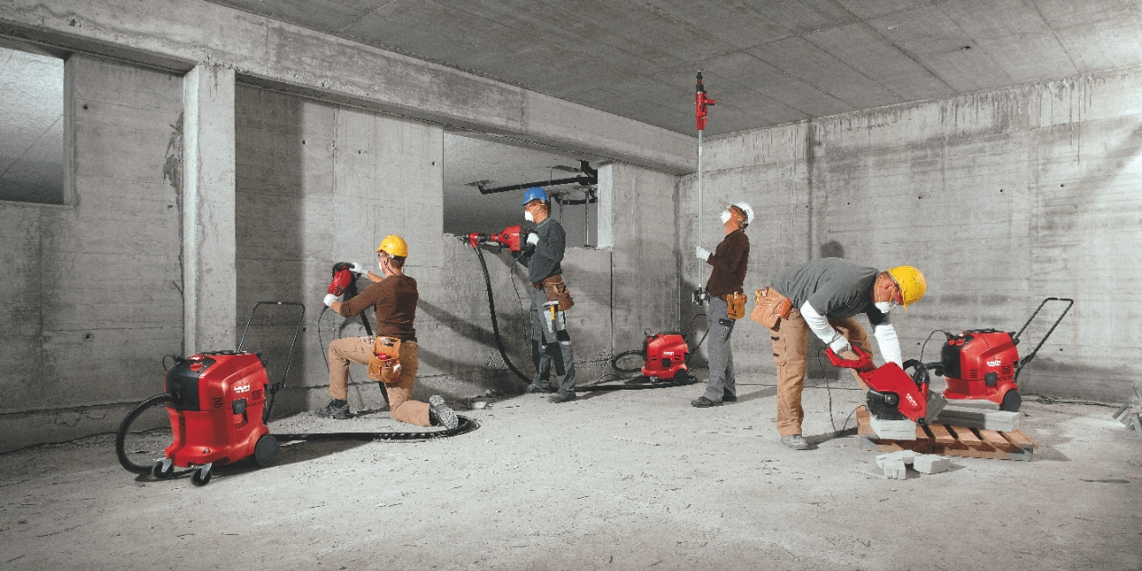 Image of all the full portfolio of Hilti vacuum cleaners being used on the construction site