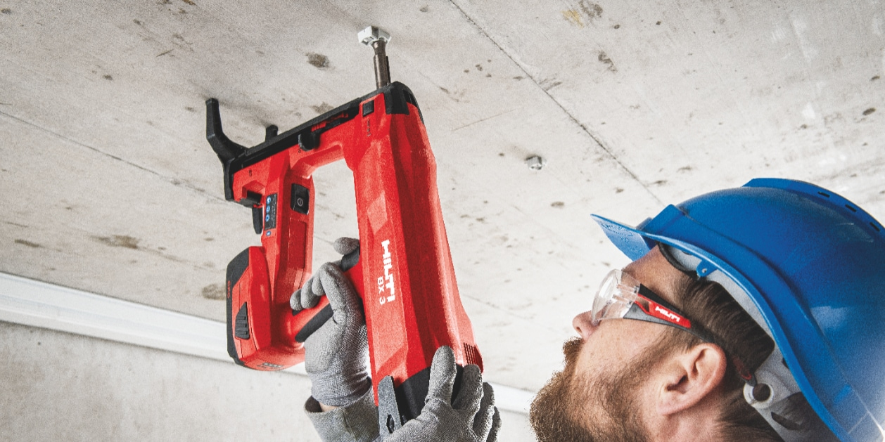BX 3 battery-powered nailer, a virtually dust-free alternative to drilling, being used to fasten on concrete
