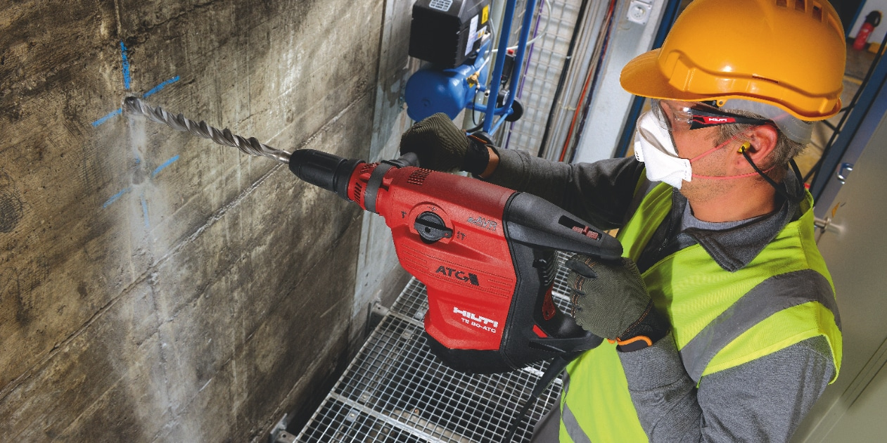Construction worker using a TE 80-ATC/AVR Corded combihammer  with Active Torque Control (ATC) to help prevent kickback