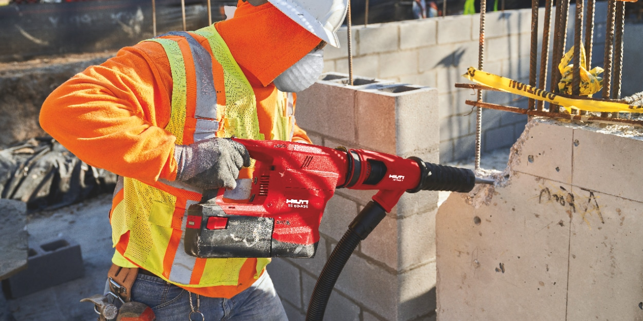 Construction worker using a TE 60-A36 Cordless combihammer  with Active Torque Control (ATC) to help prevent kickback