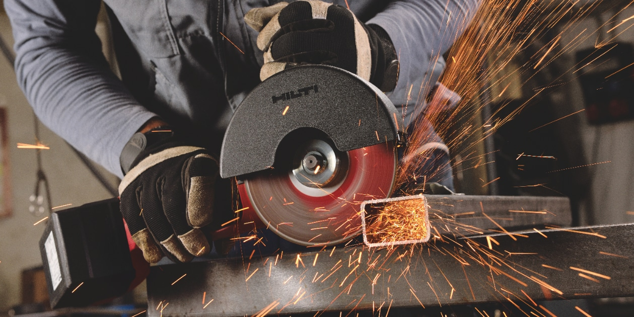 Construction worker using a AG 600-A36 Cordless angle grinder with Active Torque Control (ATC) to help prevent kickback