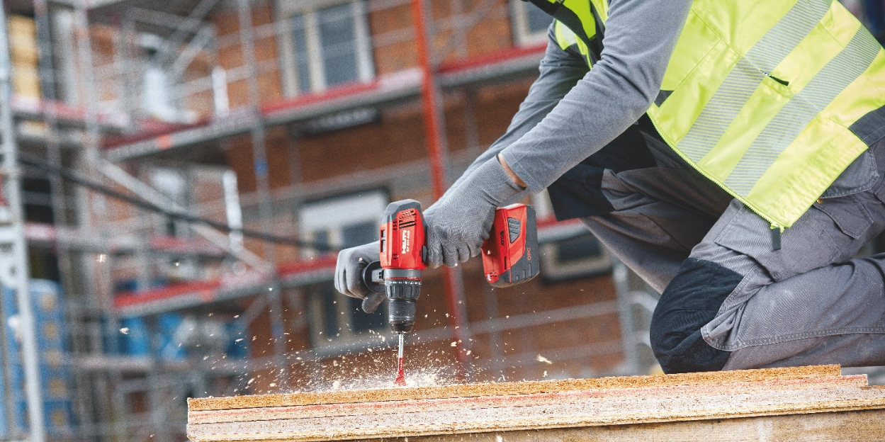 Construction worker using a n SF 6H-A22 Cordless hammer drill driver with Active Torque Control (ATC) to help prevent kickback
