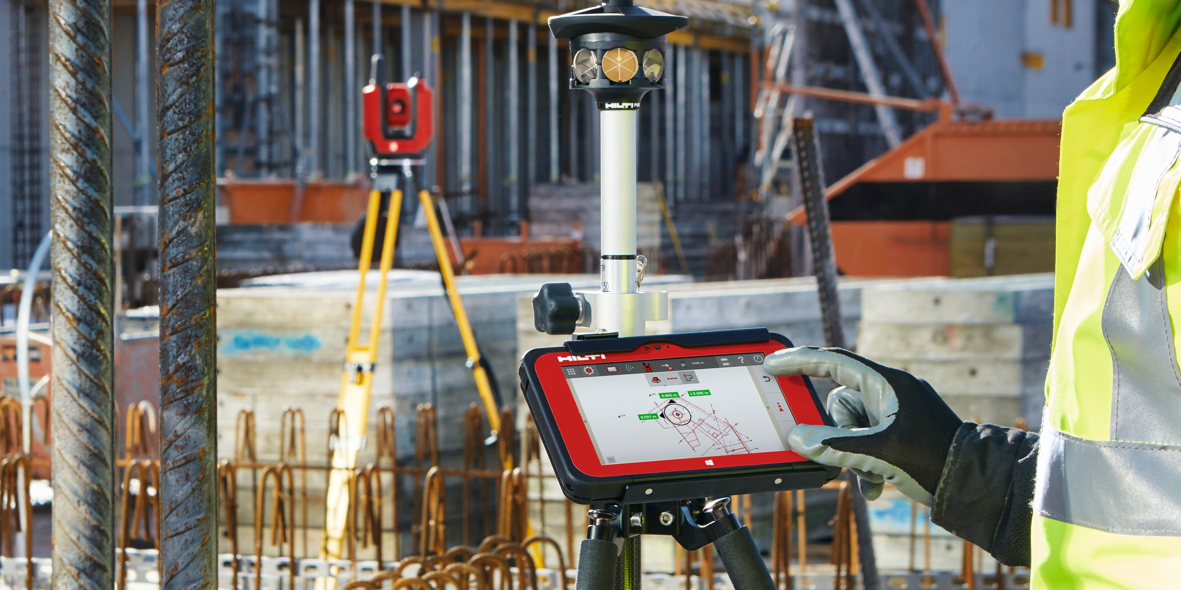 Construction worker using BIM-compatible layout tool to locate building elements on a jobsite