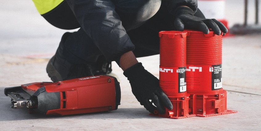 Hilti firestop cast-in sleeves for cables and pipes being placed on concrete slabs after laying them out in BIM